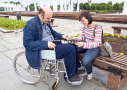 Caregiver and disable man playing chess