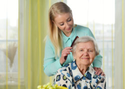 Caregiver assisting the old woman