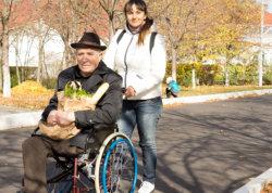 Caregiver assisting the elderly man